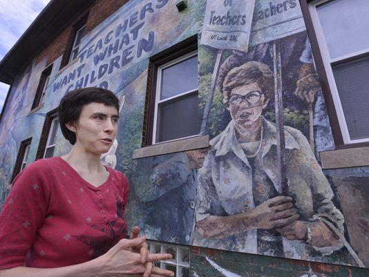 Muralist builds bridges between Detroit's past, present