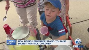 Boy_using_lemonade_stand_to_raise_money__1_43724696_ver1.0_640_480