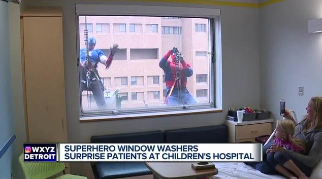 Video – Superheroes washing windows surprise kids at Children's Hospital of Michigan